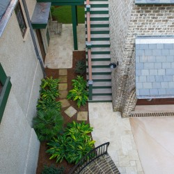 Barrier island home birdseye view of backyard patio staircases