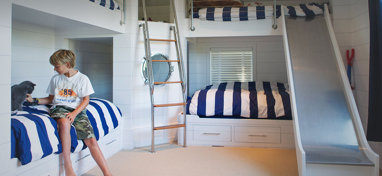nautically themed kids bedroom with bunk beds and slide